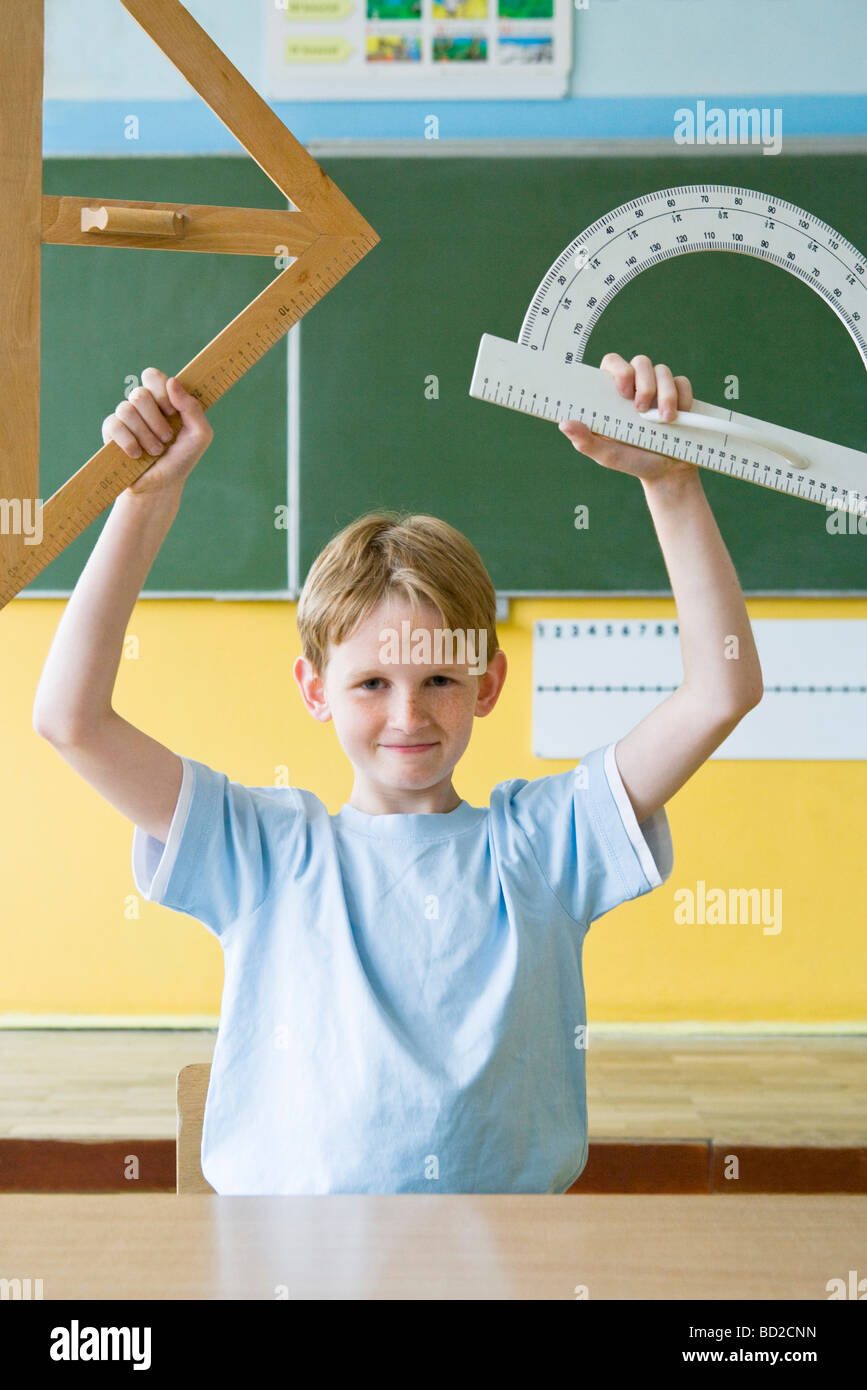 portrait of a boy with set square - Stock Image