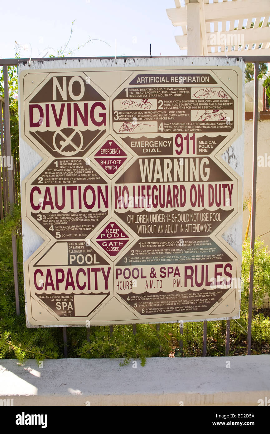 Sign posted with safety rules and cautions for pool use. - Stock Image
