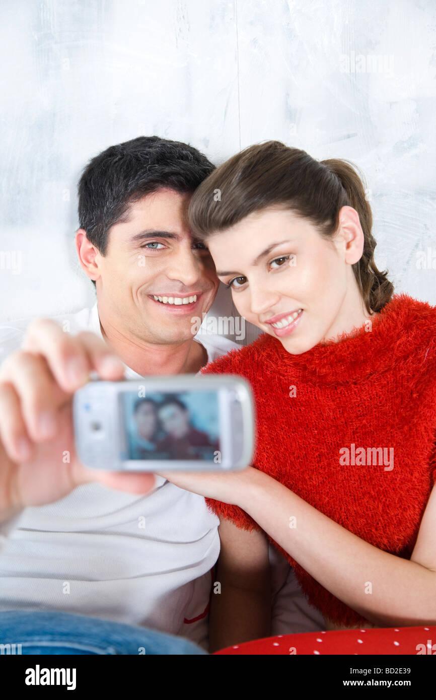 couple taking photo - Stock Image