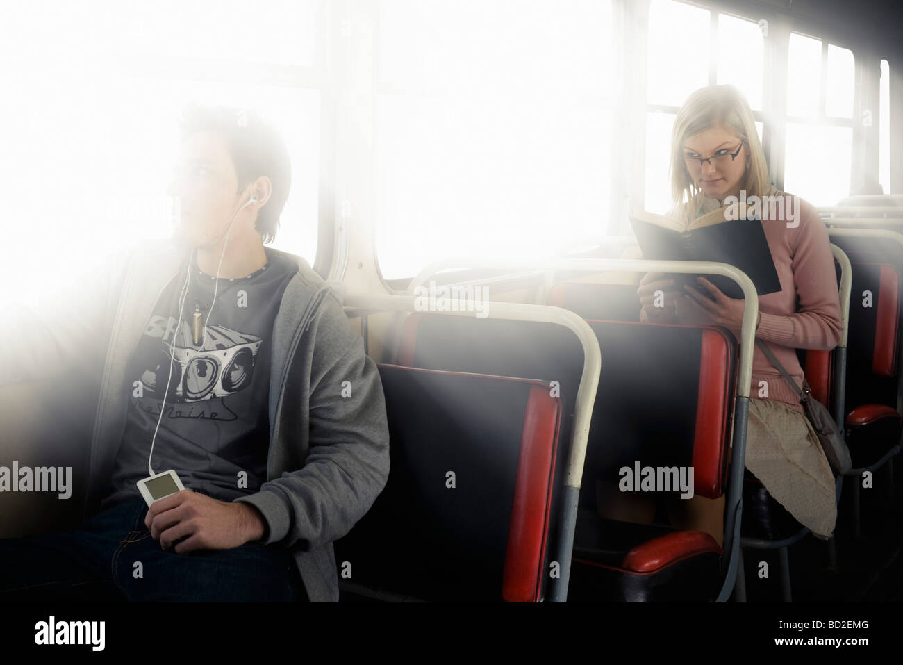 Shy girl attracted to oblivious boy - Stock Image