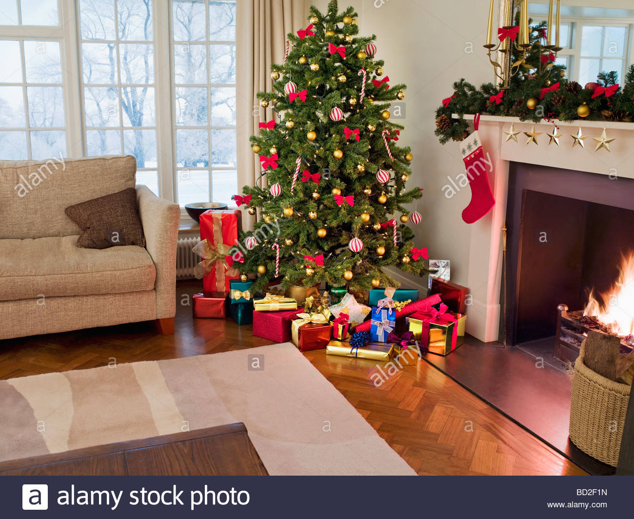 gifts under christmas tree in living room stock image