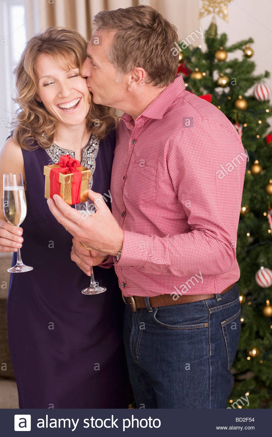 Couple kissing near Christmas tree Stock Photo