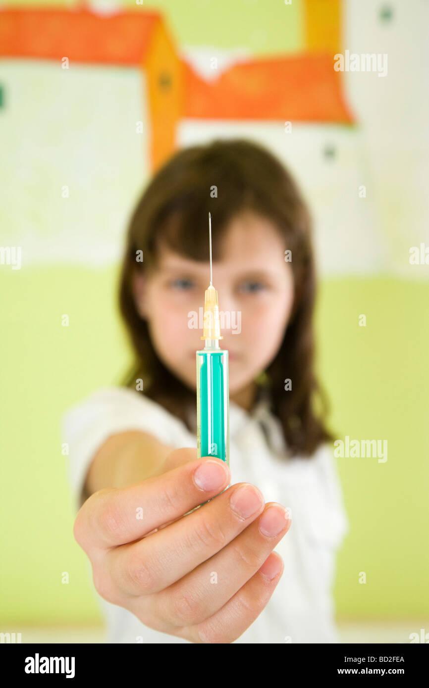 girl holding syringe - Stock Image