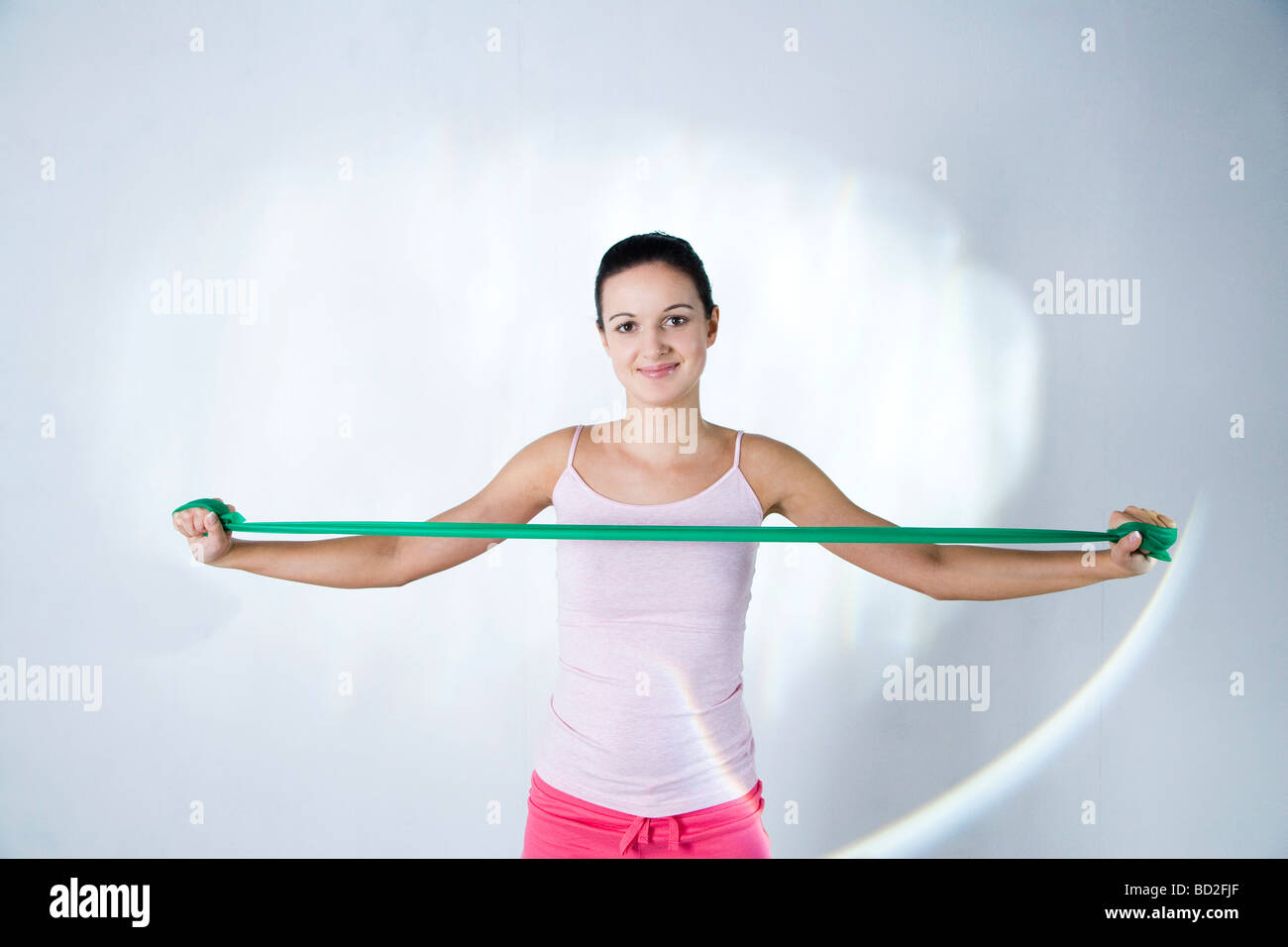 woman training with exercise band - Stock Image