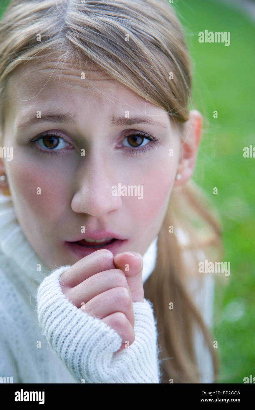 young woman with cough - Stock Image