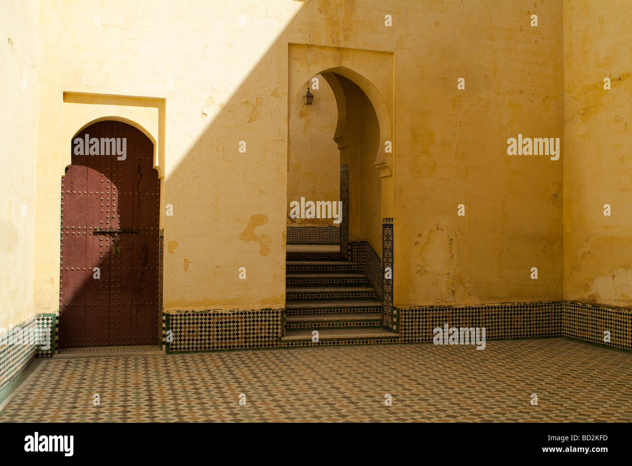 Arch and steps in the interior courtyard of the Mausoleum of Moulay Ismail Meknes Morocco Stock Photo