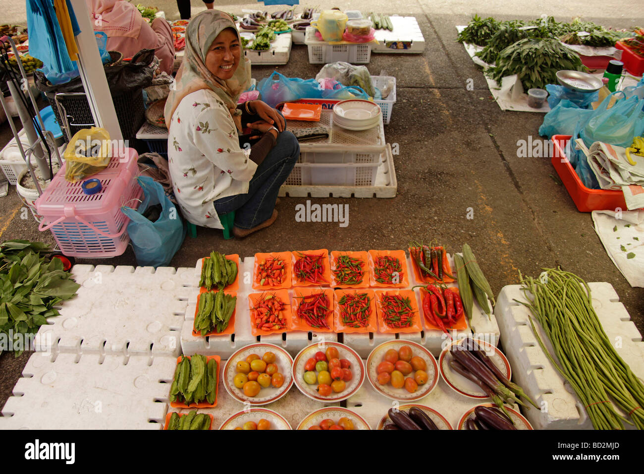 saleswoman on the market in the capital city Bandar Seri Begawan Brunei Asia - Stock Image