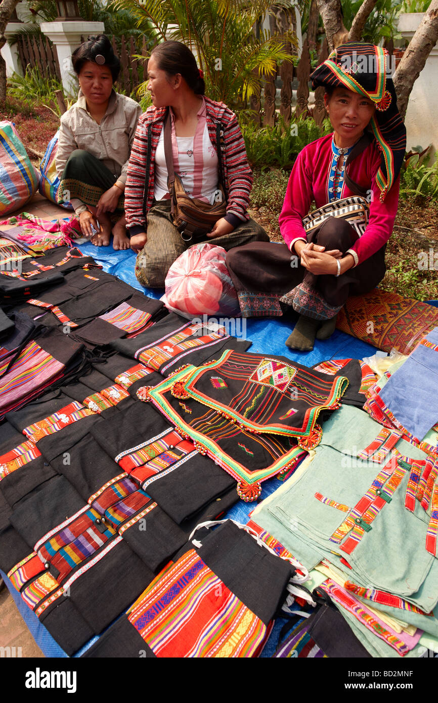 women with textiles for sale in the market in Luang Prabang Laos - Stock Image