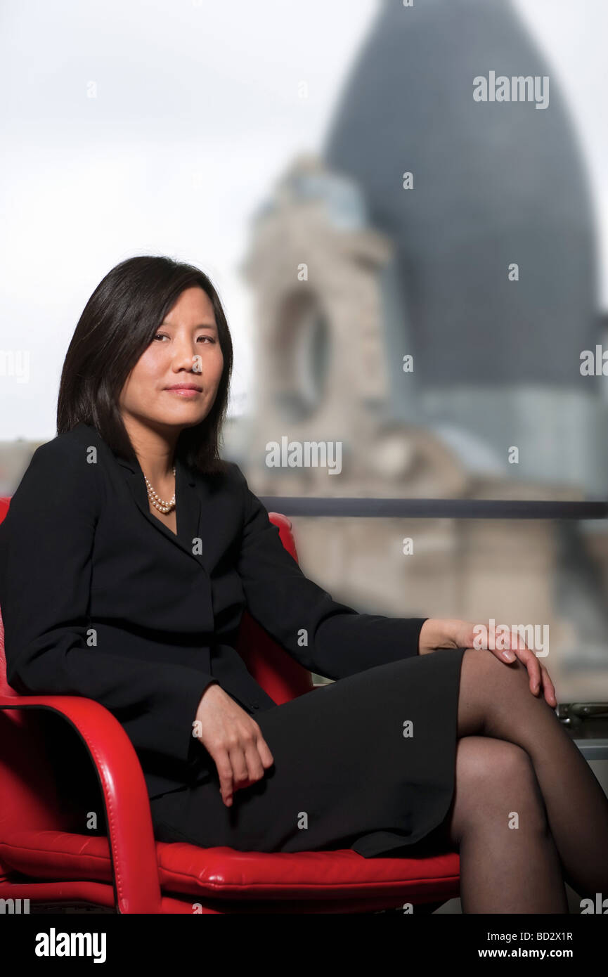 Chinese businesswoman seated, Paris - Stock Image