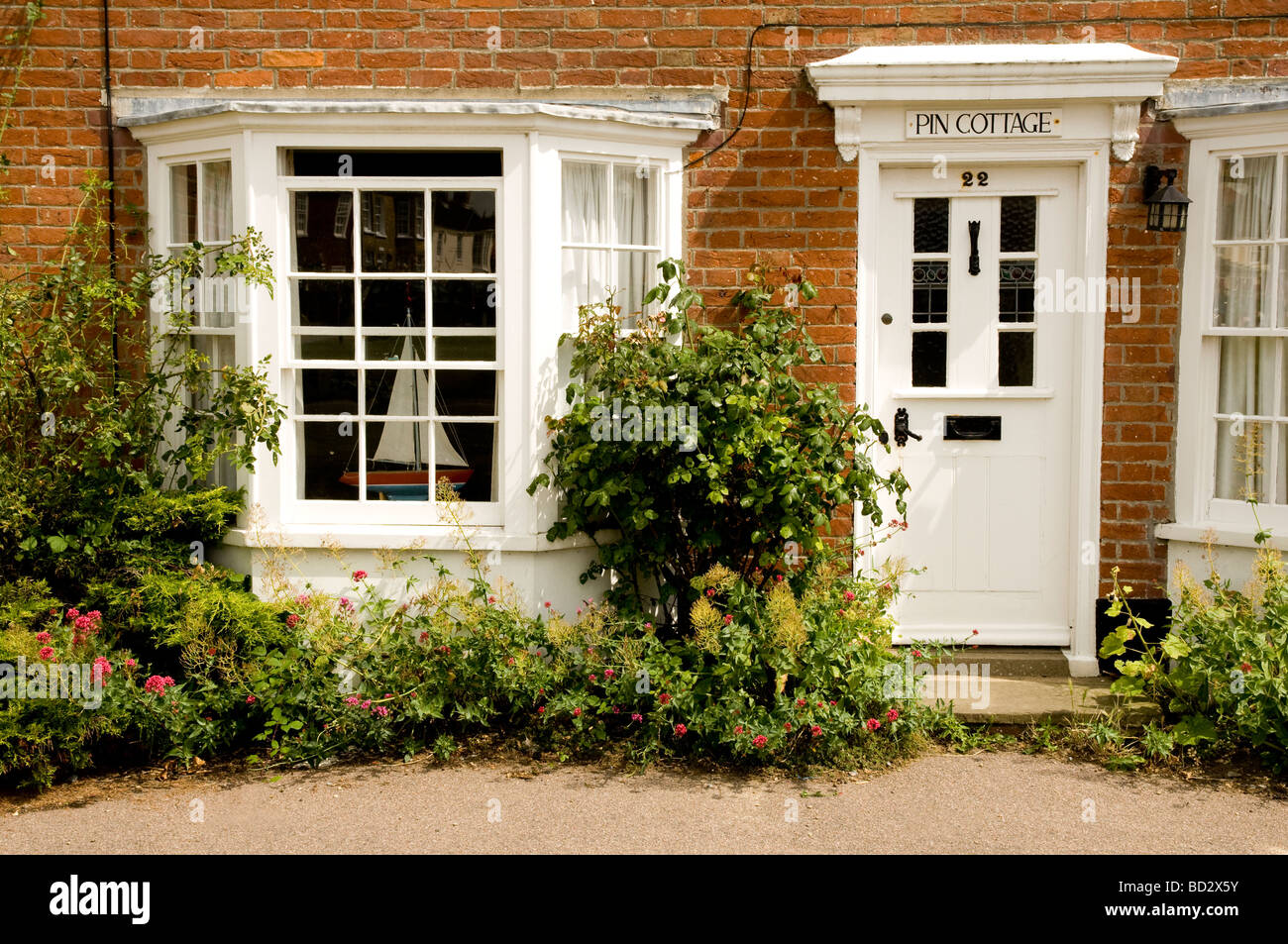 Small red brick seaside cottage in Southwold, Suffolk Stock Photo