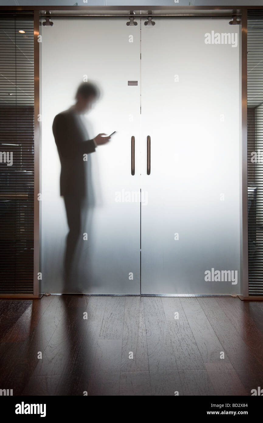 Glass door stock photos glass door stock images alamy businessman holding open glass doors stock image planetlyrics