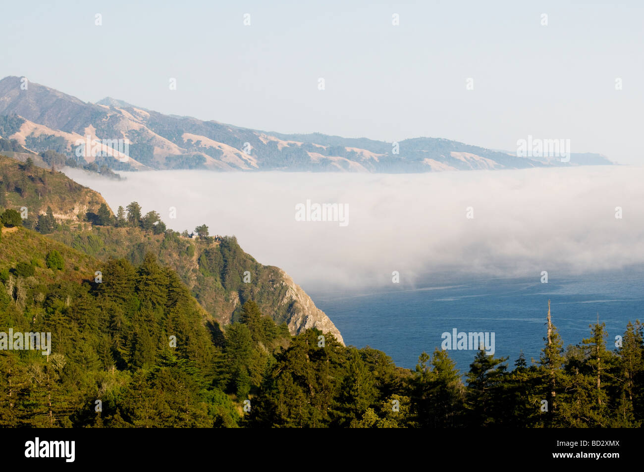 overlooking  the fog Big Sur California coast - Stock Image