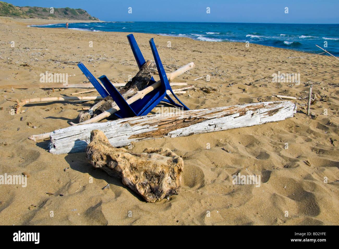 Flotsam rubbish and drift wood washed up on Mounda beach near Skala on the Greek Mediterranean island of Kefalonia - Stock Image