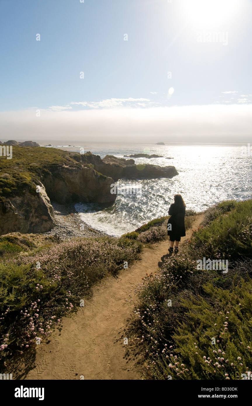 Woman overlooking the sea Big Sur California coast - Stock Image
