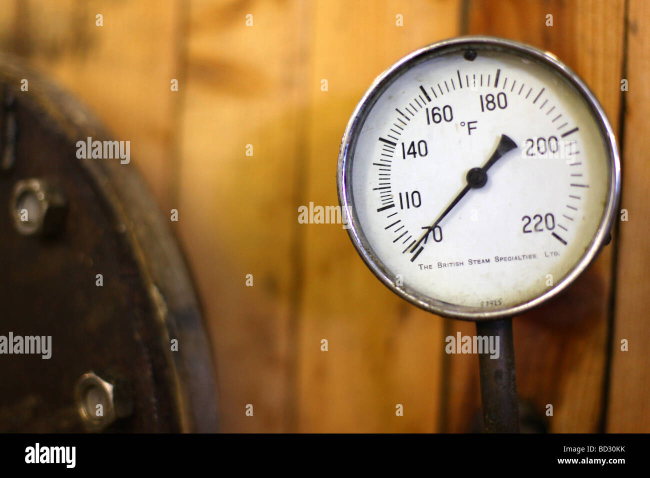 A pressure gauge on a vat of beer brewing in a brewery - Stock Image