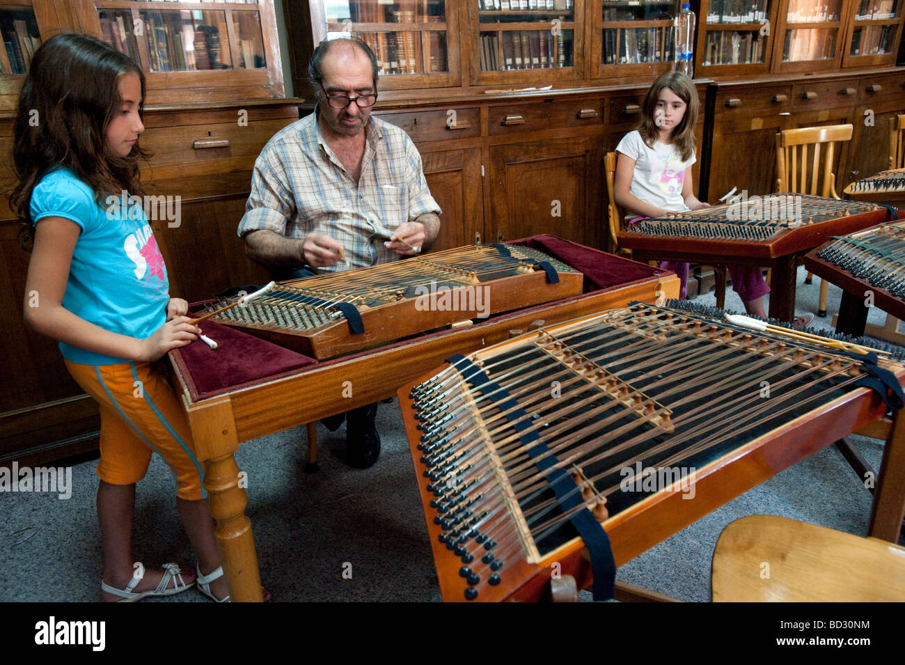 Greek children at music lesson learning to play traditional santouri stringed instrument in Agiassos on Lesvos Island - Stock Image