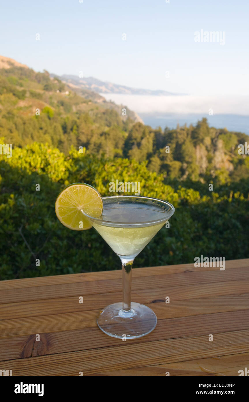 Cocktail on the bar at Nepenthe restaurant overlooking  Big Sur California coast - Stock Image
