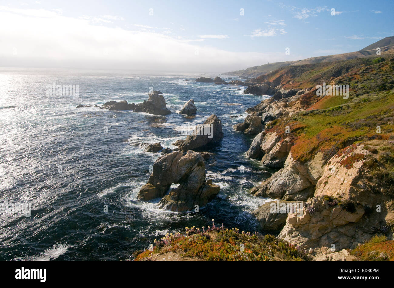 rocky cliffs on the coast of Big Sur California - Stock Image