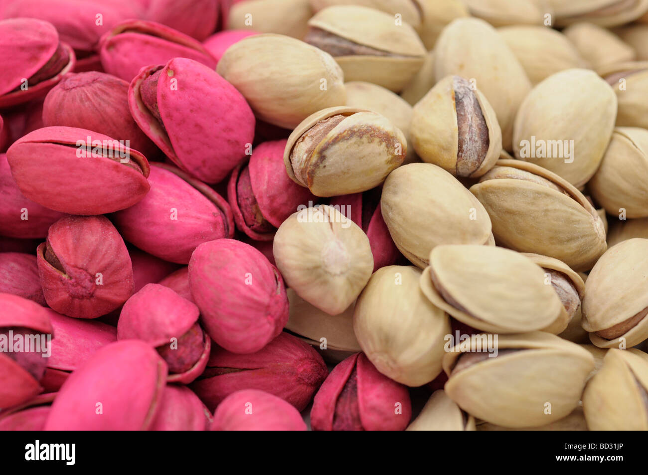 Pink Dyed and Natural color Pistachios - Stock Image