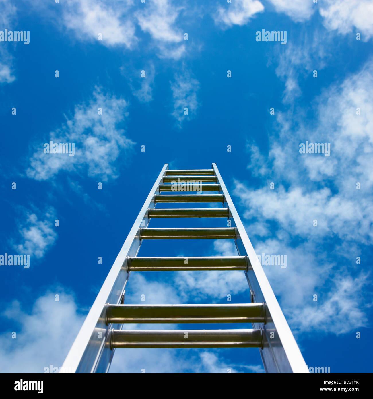 Ladder against blue sky. - Stock Image