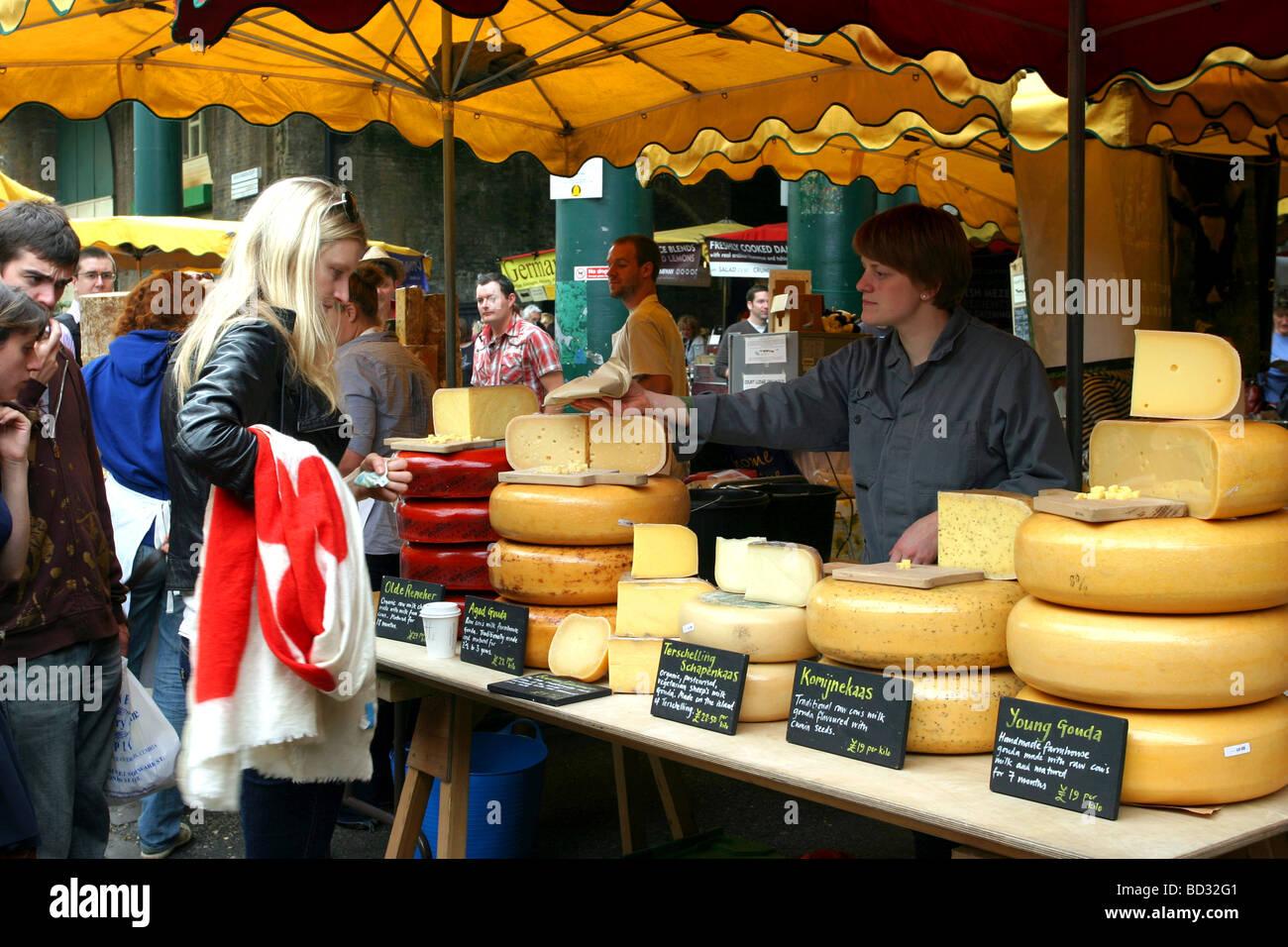 Borough Market Cheese Seller, Borough, London - Stock Image