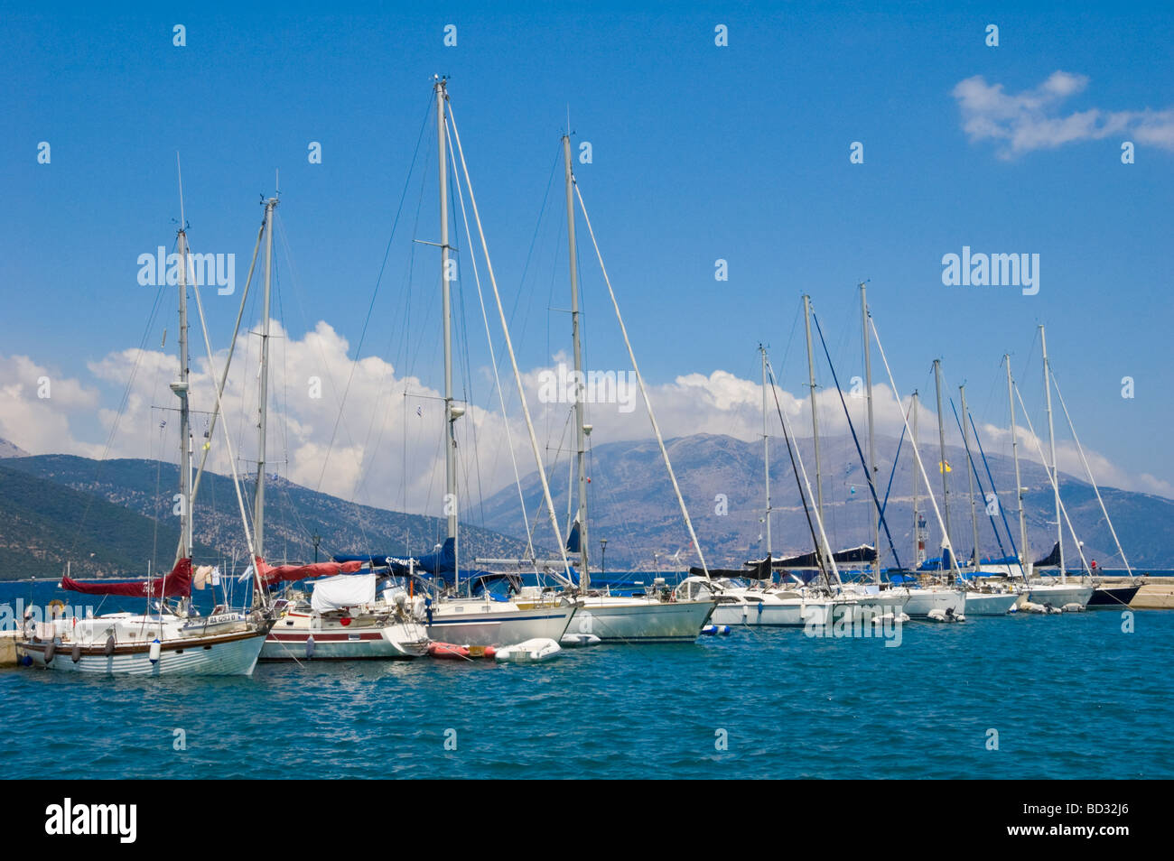 Sailing yachts moored in Sami harbour on the Greek Mediterranean island of Kefalonia Greece GR - Stock Image