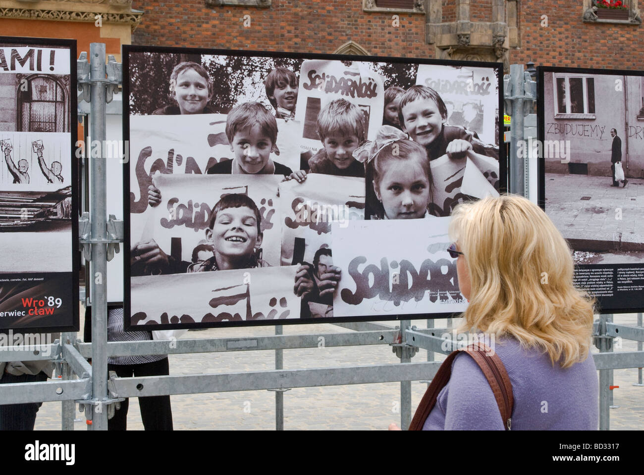 Children with SOLIDARITY signs in historic photos, Wrocław June 1989, communism collapse, displayed June 2009 in - Stock Image