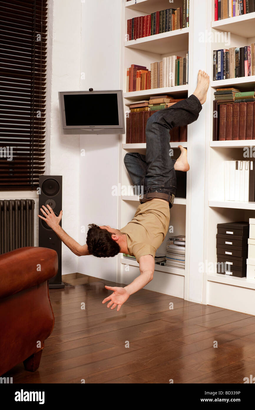 man tumbling against wall - Stock Image