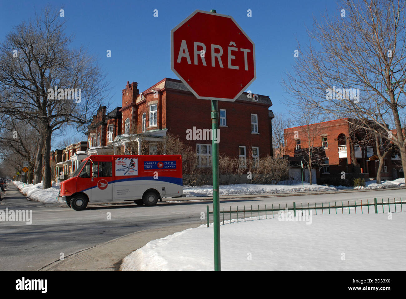 Canada Postal truck in front of french stop sign Montreal  Quebec Montreal - Stock Image