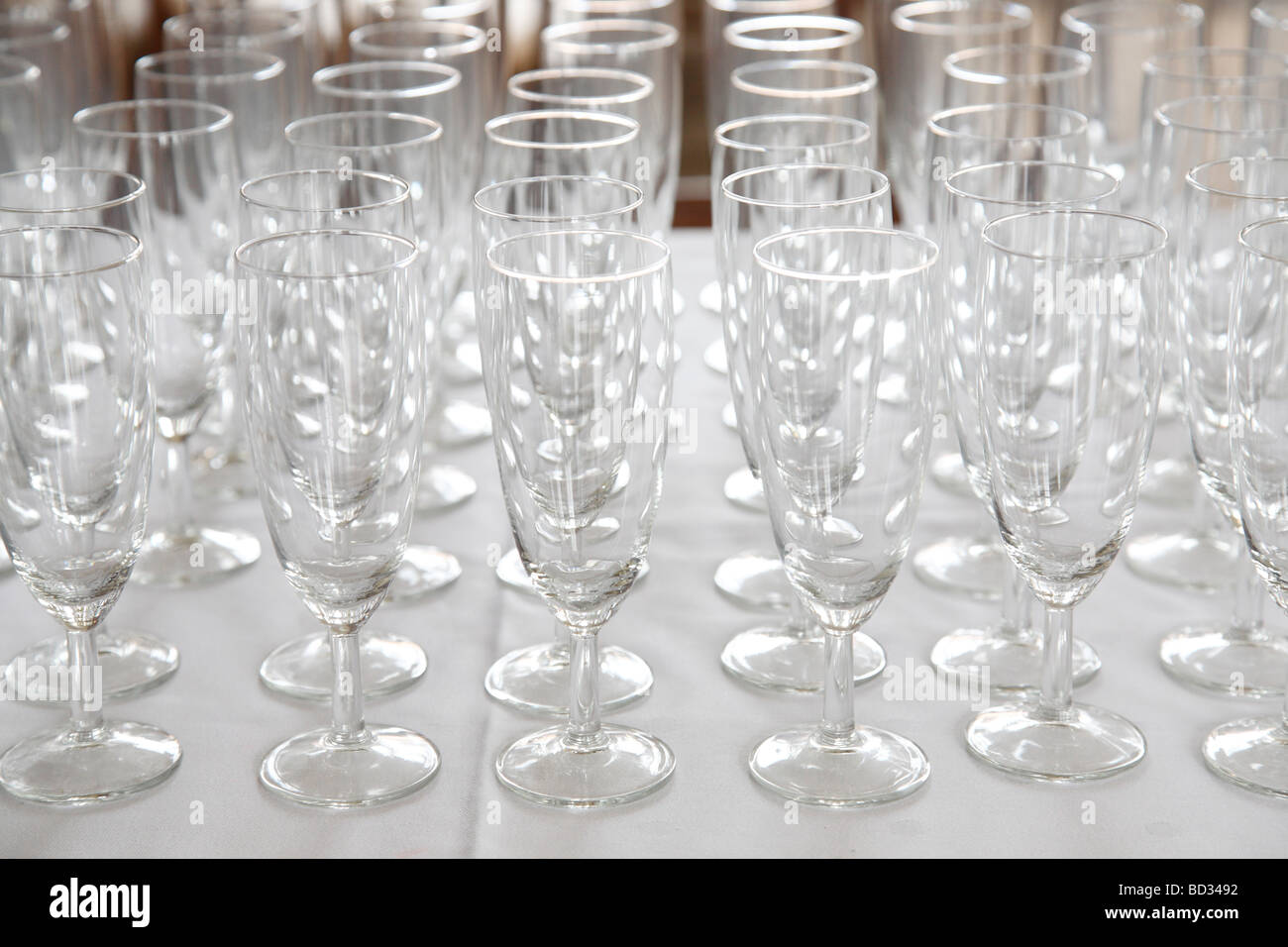 many empty champagne glasses - Stock Image