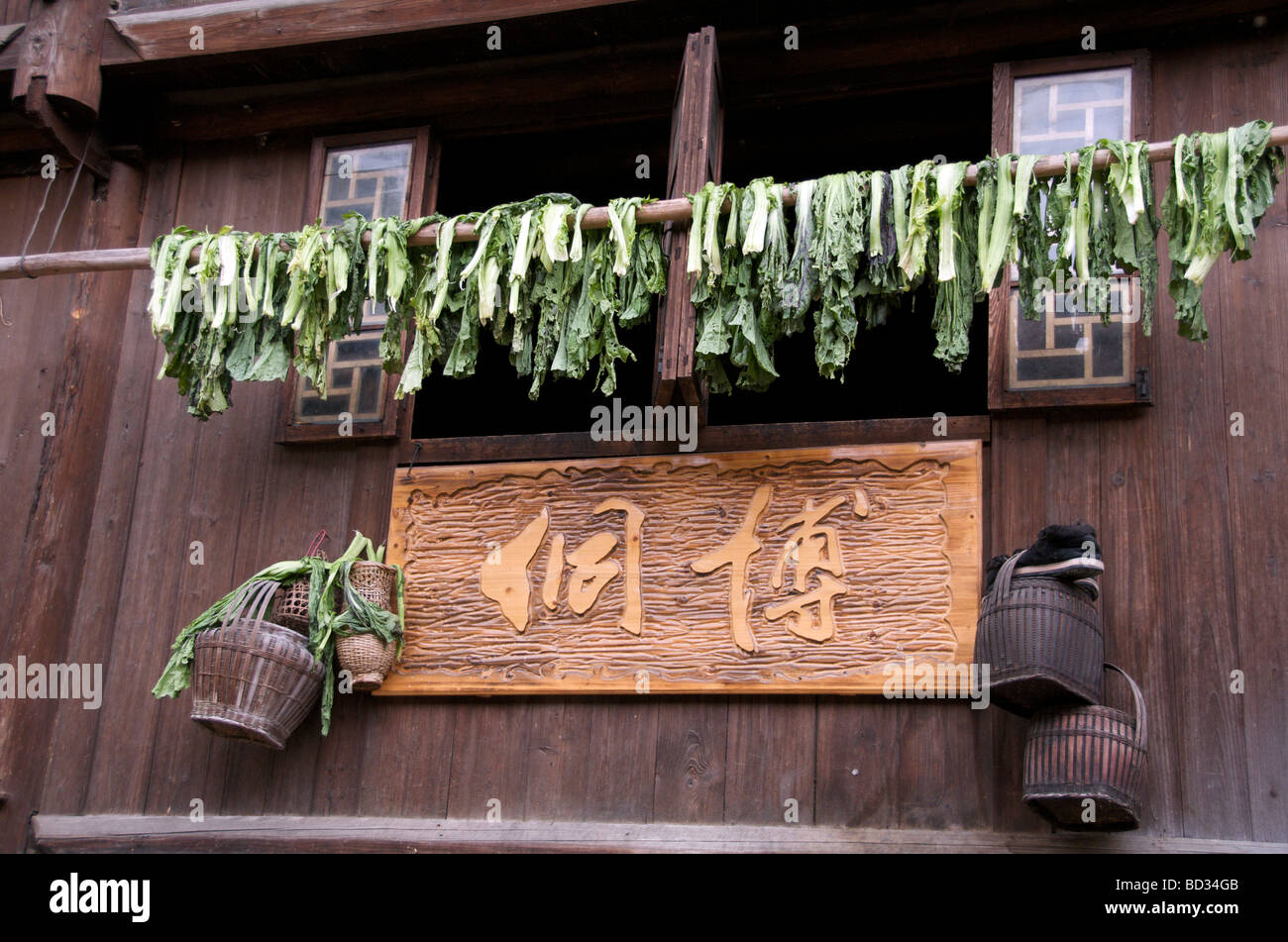 Vegetables drying outside a wooden house which characterizes a Dong Village Zhaoxing Guizhou Province China Stock Photo