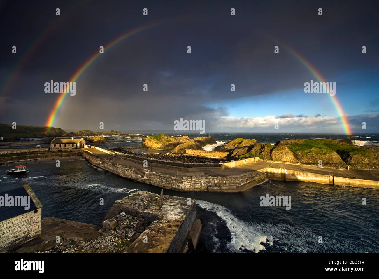 Beautiful double rainbow over Ballintoy harbour, Co Antrim in N, Ireland. - Stock Image