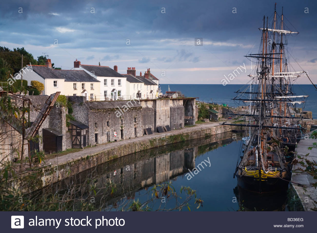 Tall ships docked in historic Charlestown Harbour on the coast of Cornwall, England Stock Photo