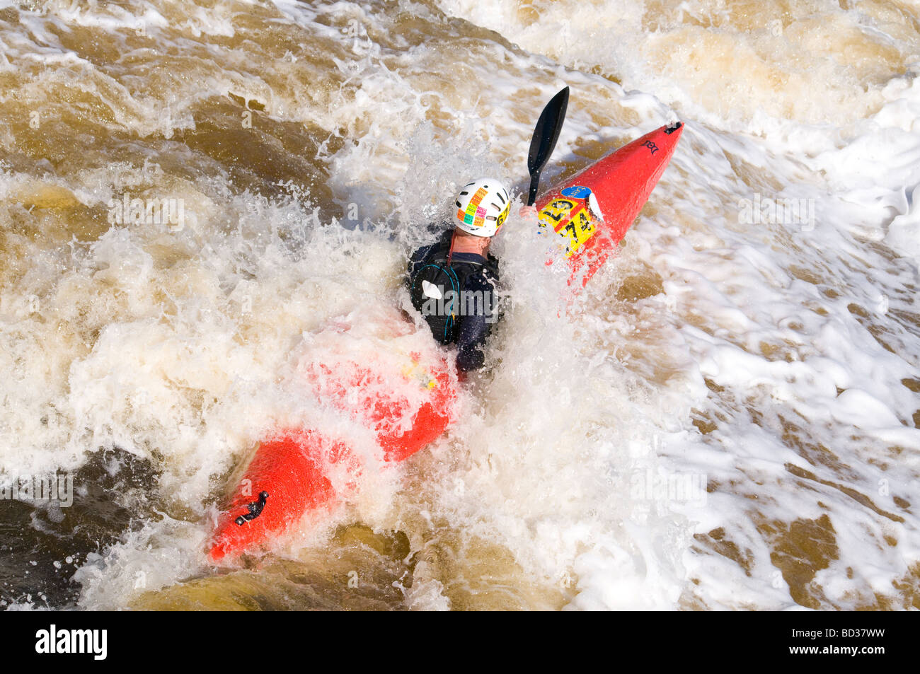 Kayaker shooting Bells Rapids in the annual West Australian whitewater classic the Avon Descent  - Stock Image