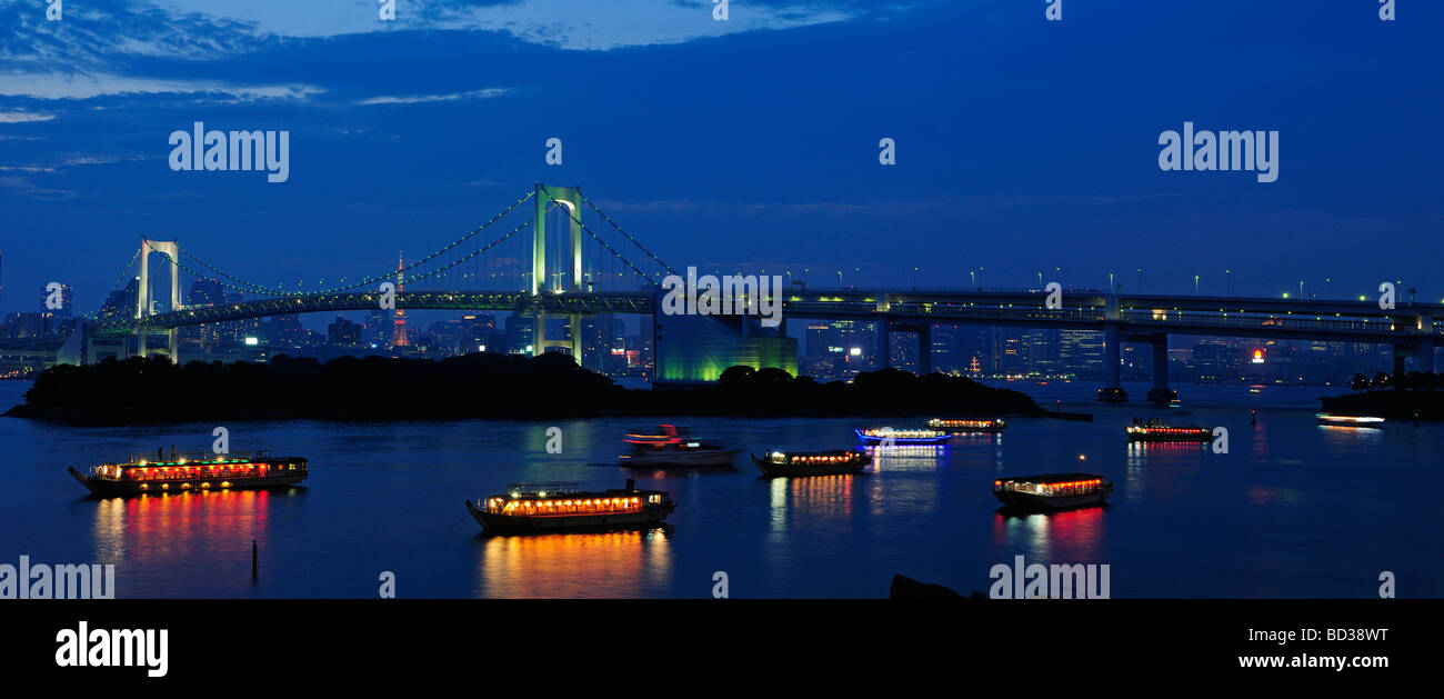 The Rainbow Bridge and Tokyo city skyline at dusk Japan - Stock Image