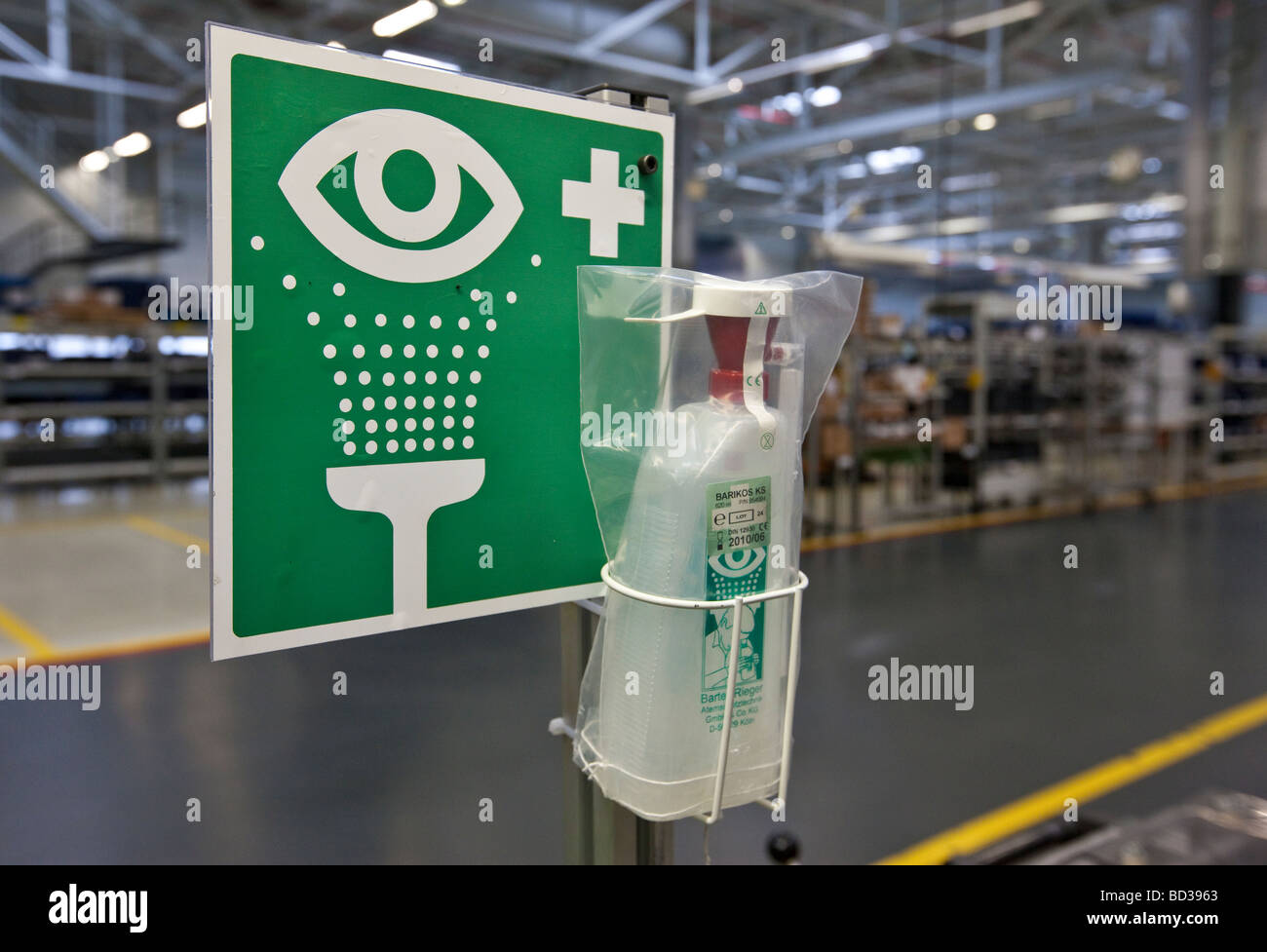 First aid for eye injuries in an engine works, Germany - Stock Image