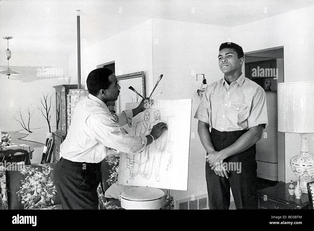 MUHAMMAD ALI  is sketched by his father Cassius,a commercial artist, at their home in Louiseville Kentucky, about - Stock Image