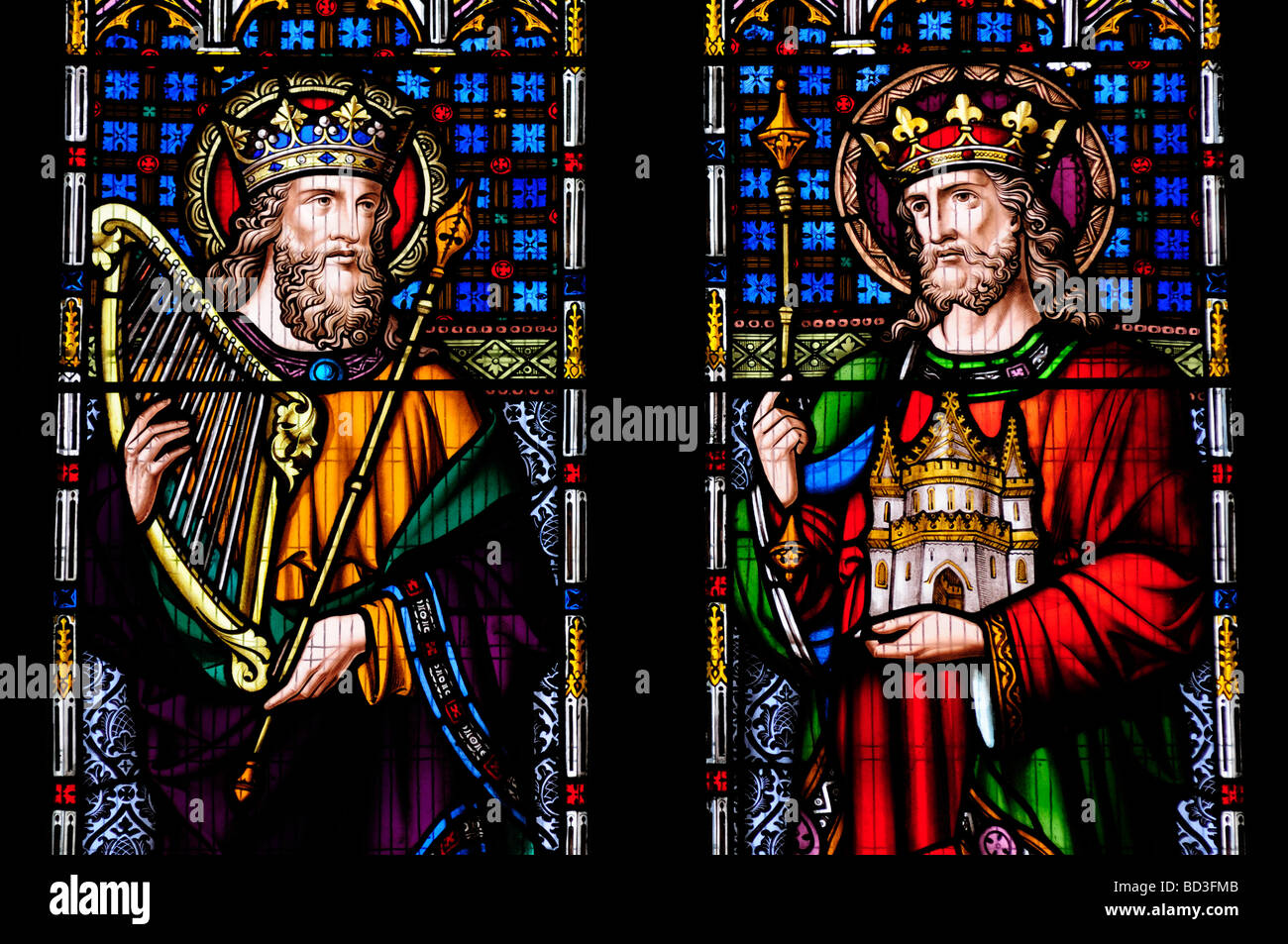 A Stained Glass Window in Peterborough Cathedral featuring King David and King Solomon, Cambridgeshire England UK Stock Photo