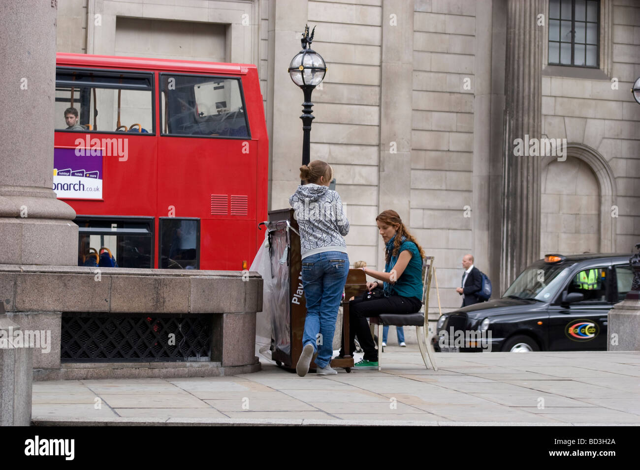 One of 30 pianos placed on streets public places and train stations as an art installation threadneedle street London - Stock Image