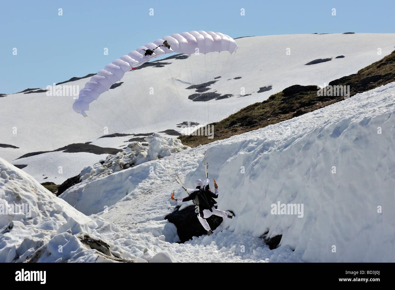Paraglider landing landing in snow Stock Photo