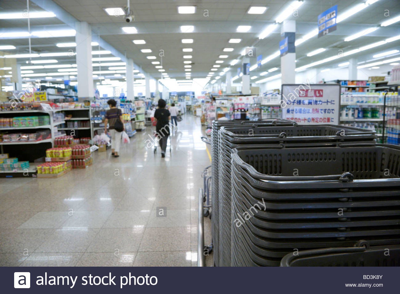 Japanese store with many shopping baskets at the entrance - Stock Image