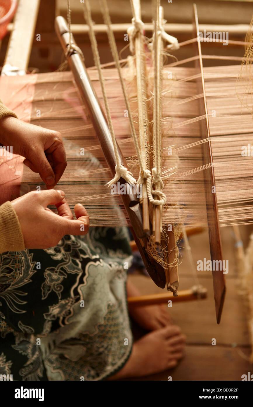 silk weaving in Luang Prabang, Laos - Stock Image