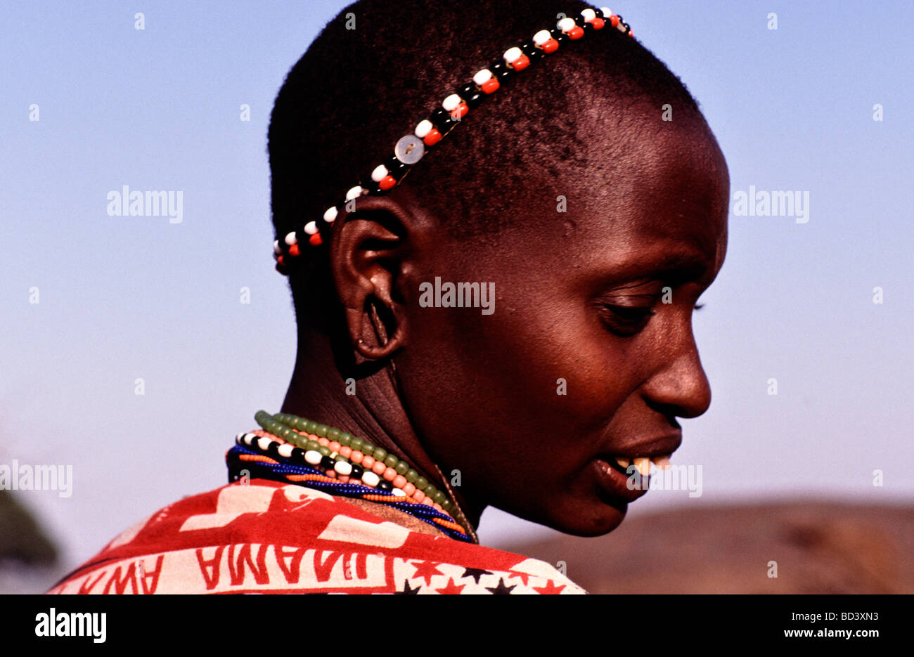 This is the head only of a Masai woman in the Masai Mara Game Reserve in South-West Kenya Africa Stock Photo