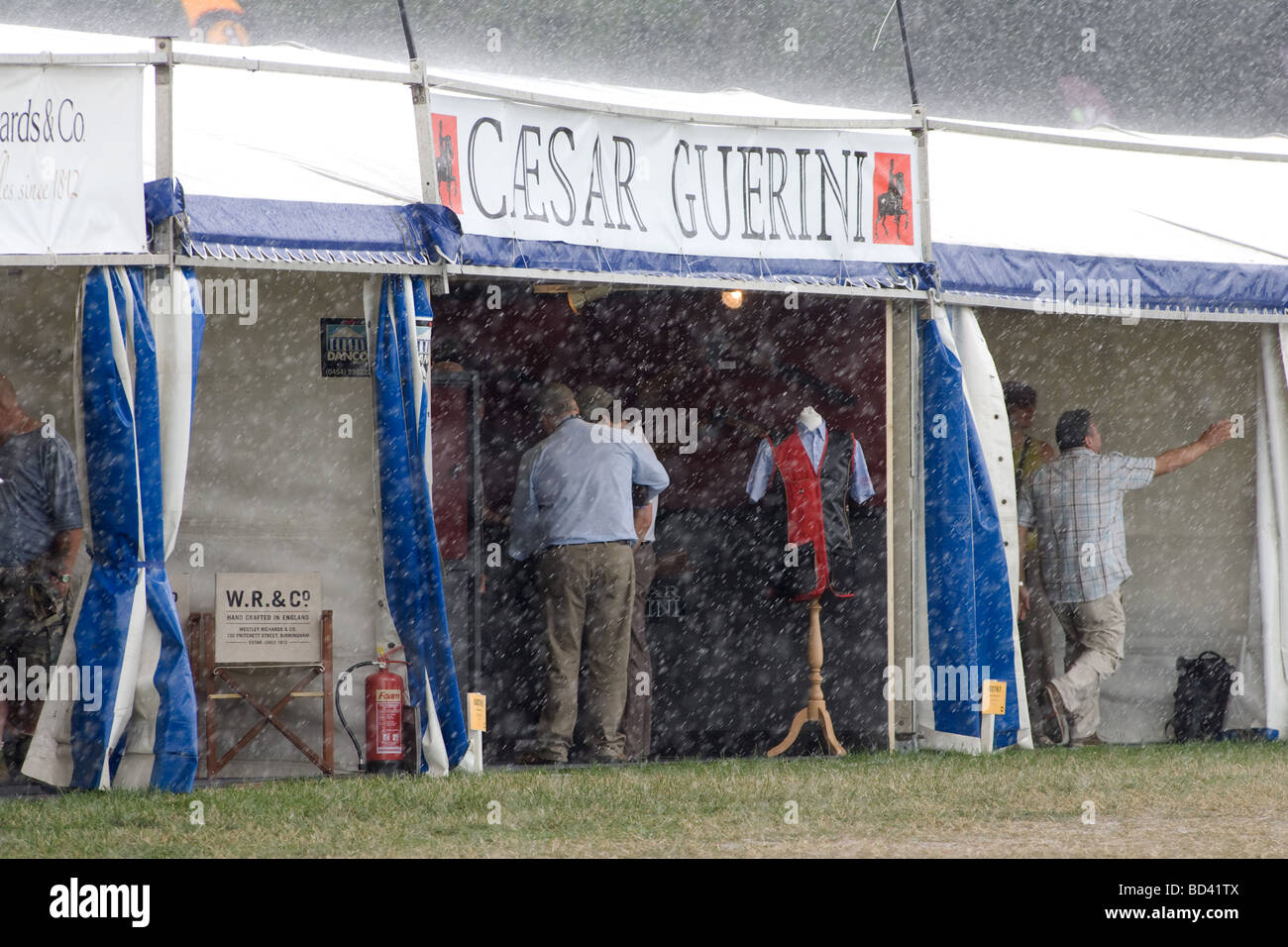Crowds Sheltering From The Rain At A Game Fair - Stock Image