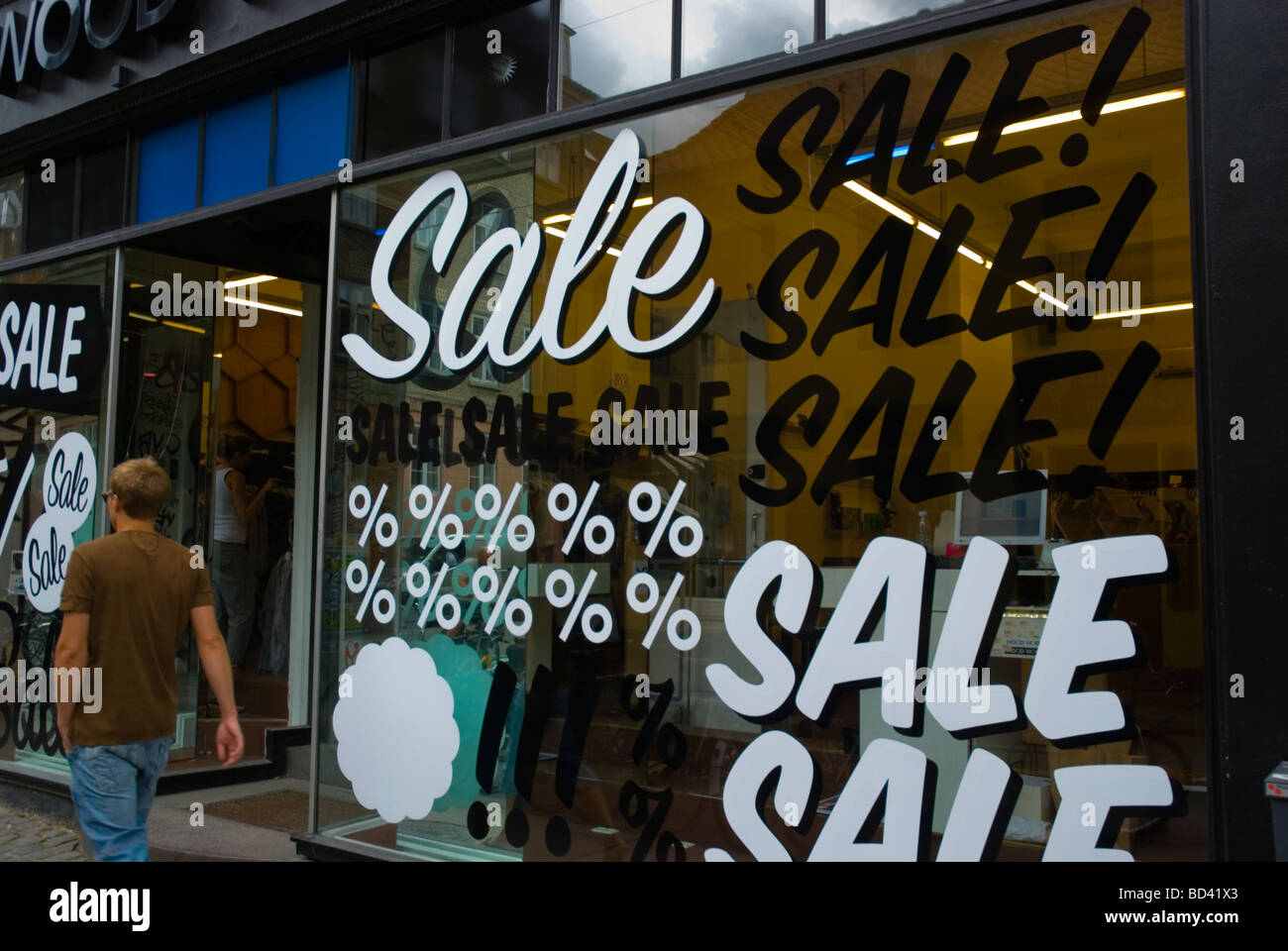 On Sale signs in a shop window in central Copenhagen Denmark Europe - Stock Image