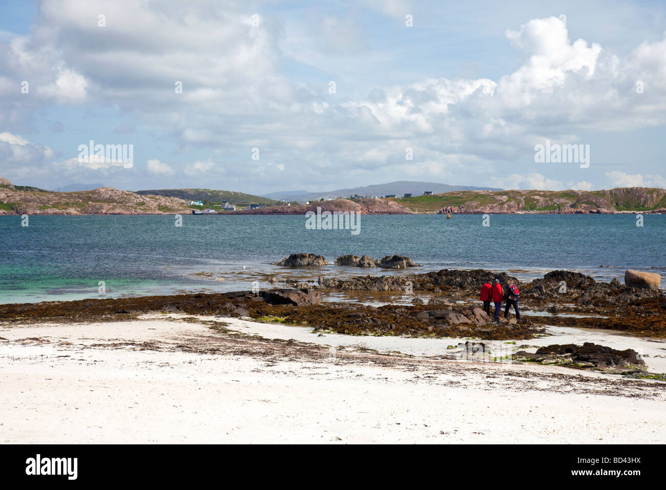 A white sandy beach on the Scottish island of Iona, looking over the sound of Iona to Fionnphort on the island of - Stock Image