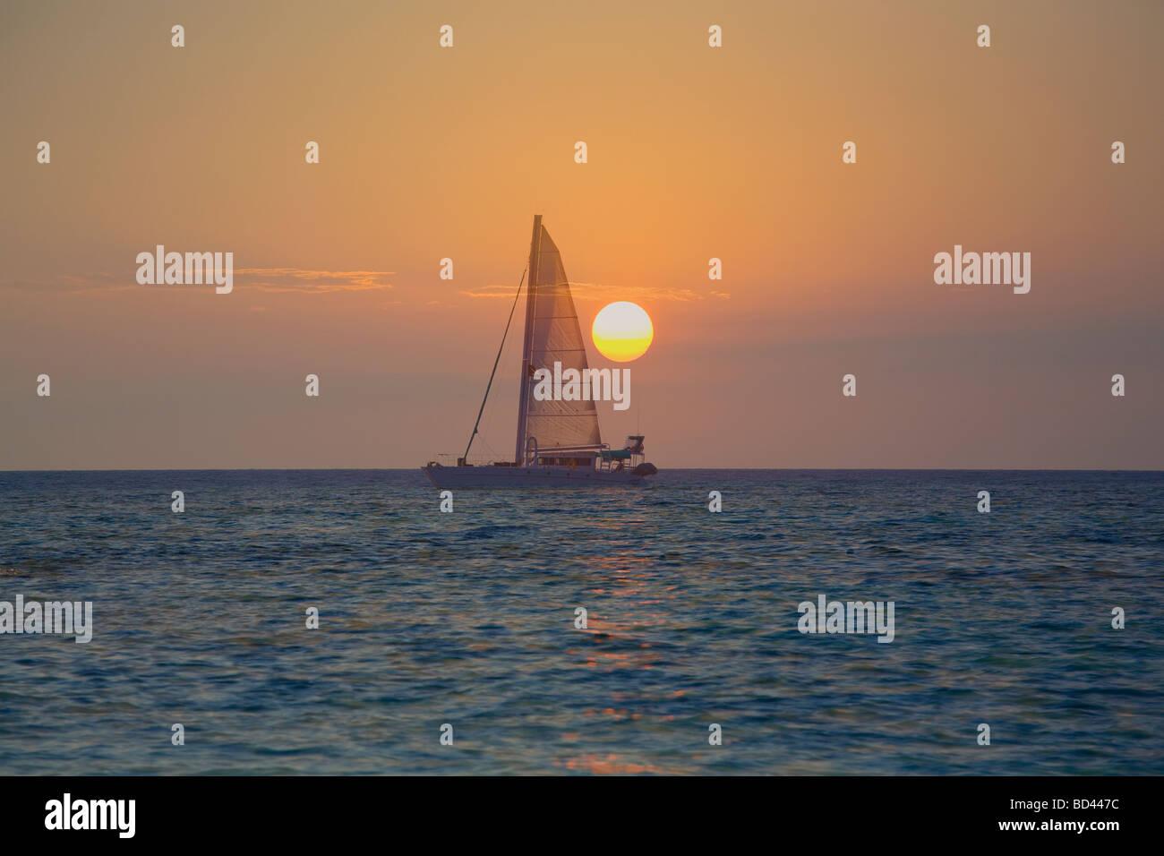 Sailboat against the sunrise, Roatan Island, Honduras - Stock Image