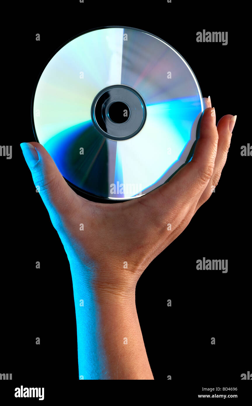 A woman s hand holding a compact disc - Stock Image