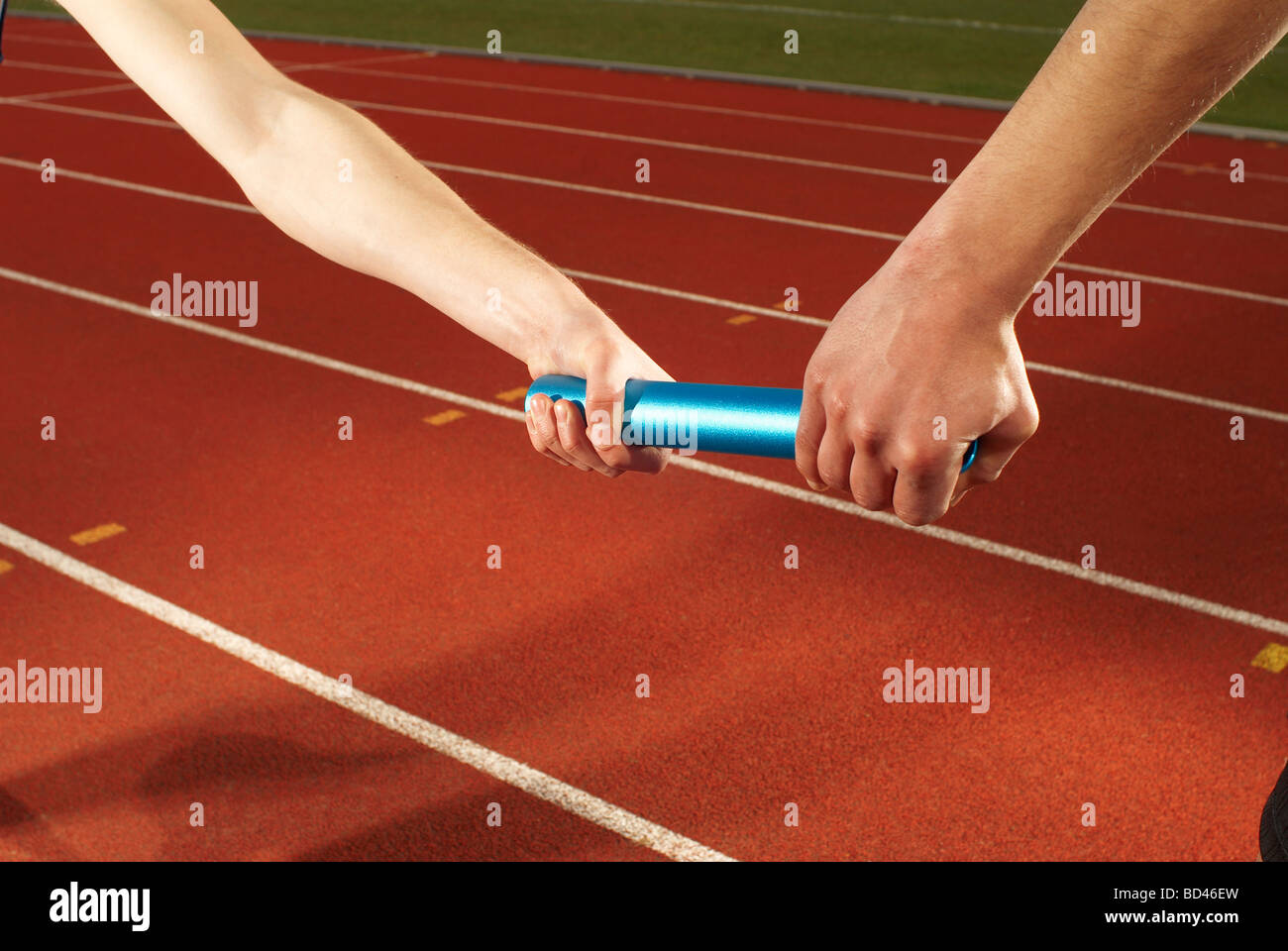 relay baton being exchanged - Stock Image