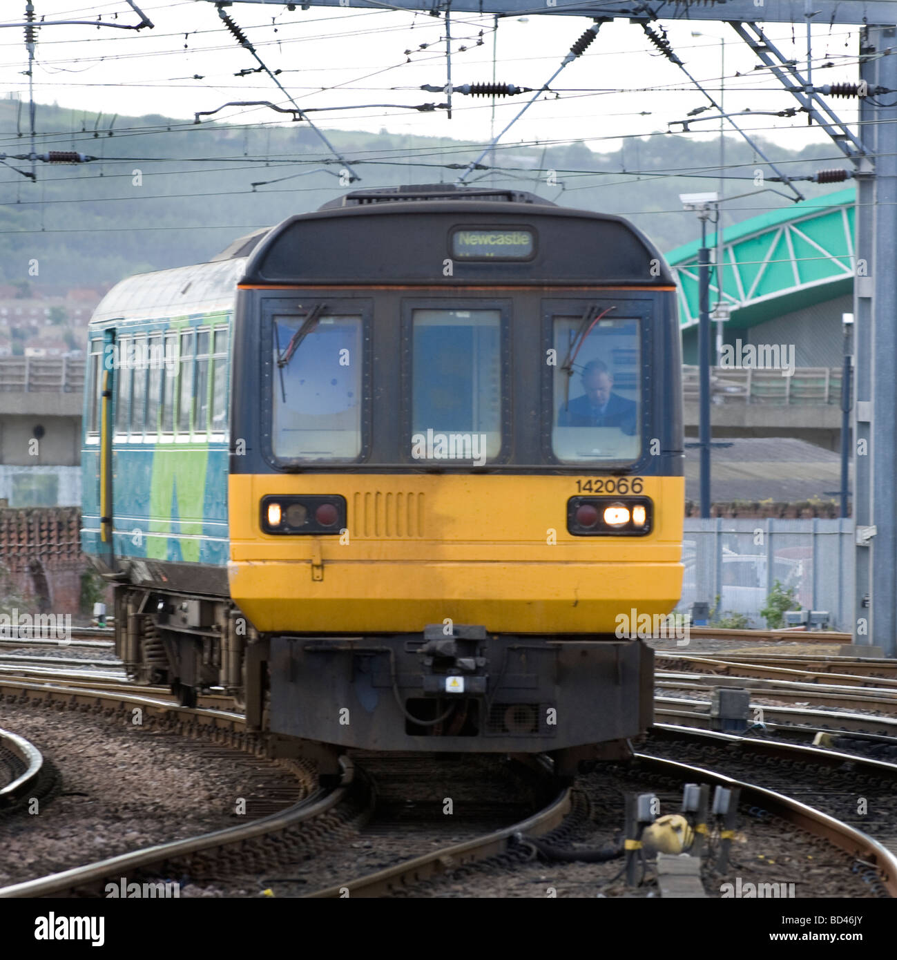 British Class 142 commuter train approaches Newcastle station, Newcastle upon Tyne, Tyne and Wear, England, UK - Stock Image